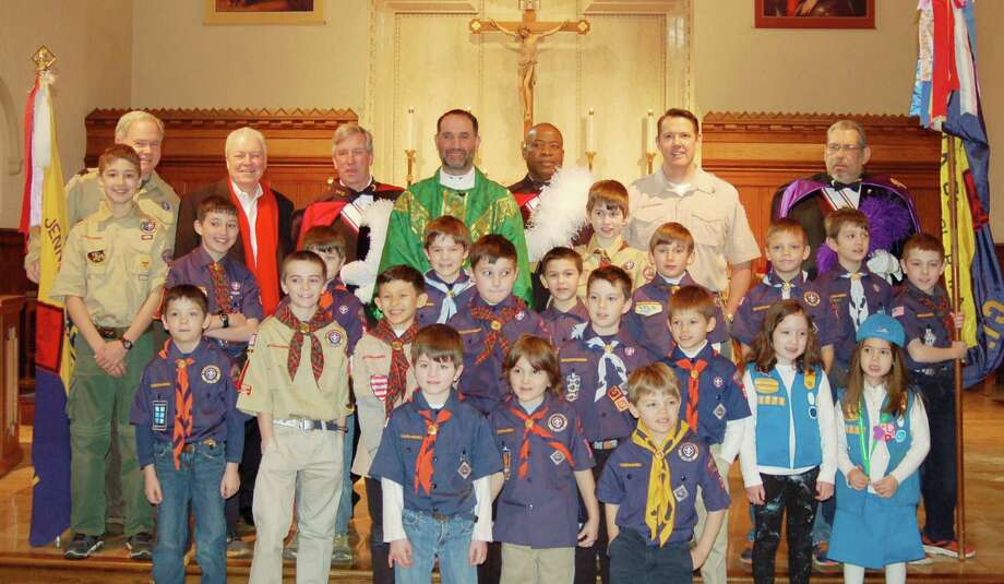 Several Cub Scouts and Girl Scouts celebrated Scout Sunday Mass at Our Lady of the Assumption Church in Fairfield Feb 5. First Selectman Mike Tetreau, as well as the Knights of Columbus, joined Girl Scout Troop 3073, Boy Scout Troop 88 and Cub Scout dens 88, 89, 95 and 107. Photo: Contributed Photo / Fairfield Citizen