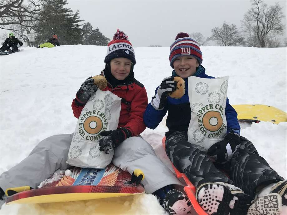 These kids celebrated the snow day and National Bagel Day in Old Greenwich on Thursday, Feb. 9, 2017. Photo: Candace Smoller, Contributed
