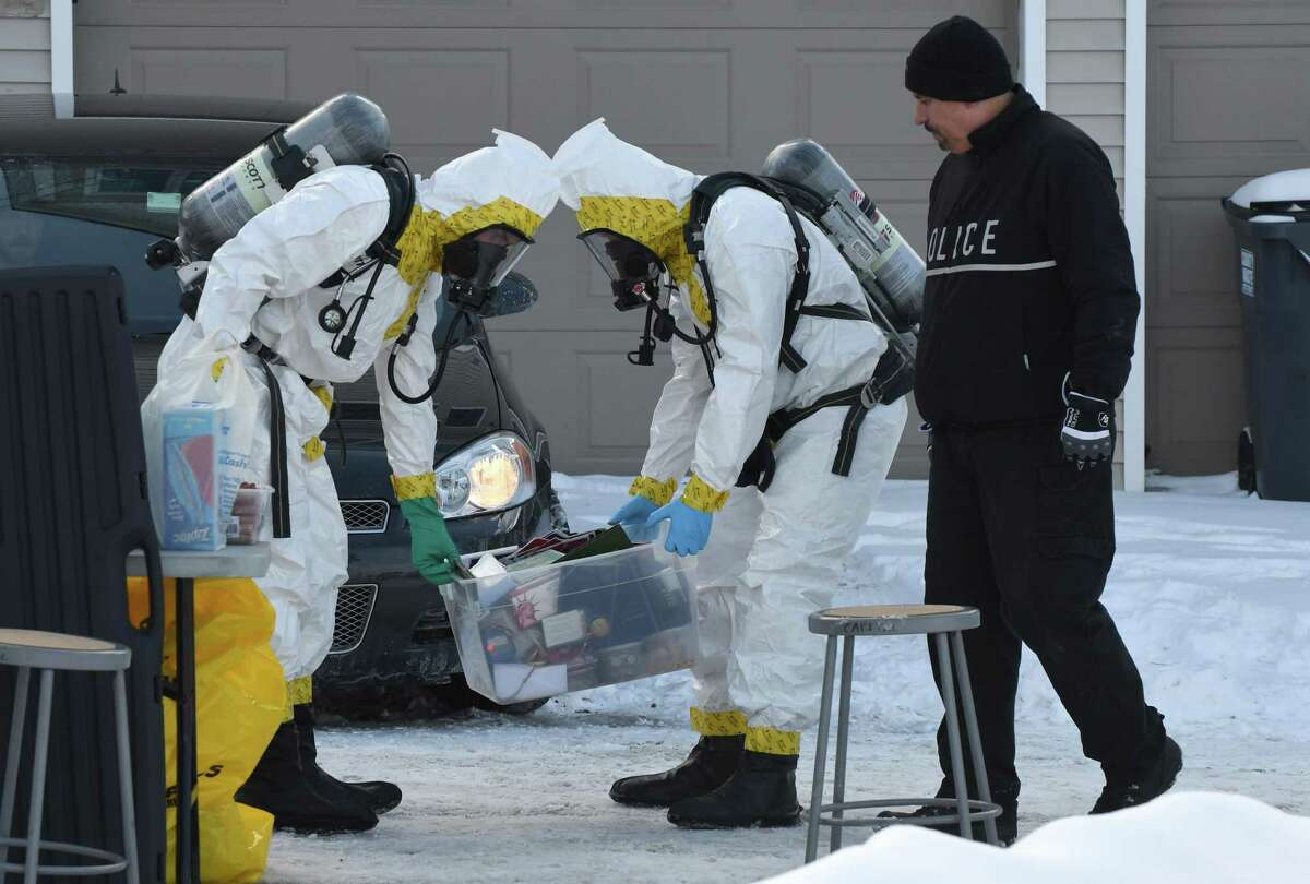 Evidence is collected from 16 Cherry St. on Friday, Feb. 10, 2017, in Saratoga Springs, N.Y. Fentanyl, a synthetic opioid painkiller that is 50 times as powerful as heroin, was found on surfaces inside the home that police raided before dawn on Friday, State Police said. (Will Waldron/Times Union)