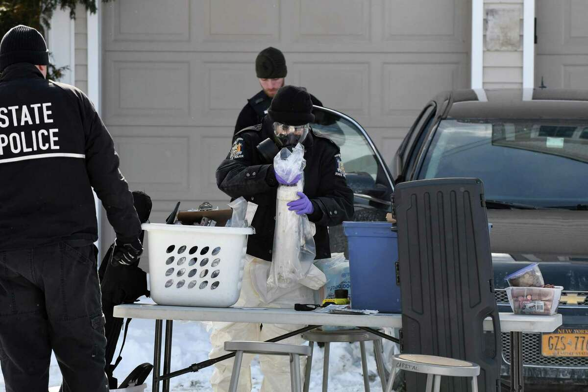 State Police secure evidence that was collected from 16 Cherry St. on Friday, Feb. 10, 2017, in Saratoga Springs, N.Y. Fentanyl, a synthetic opioid painkiller that is 50 times as powerful as heroin, was found on surfaces inside the home that police raided before dawn on Friday, State Police said. (Will Waldron/Times Union)