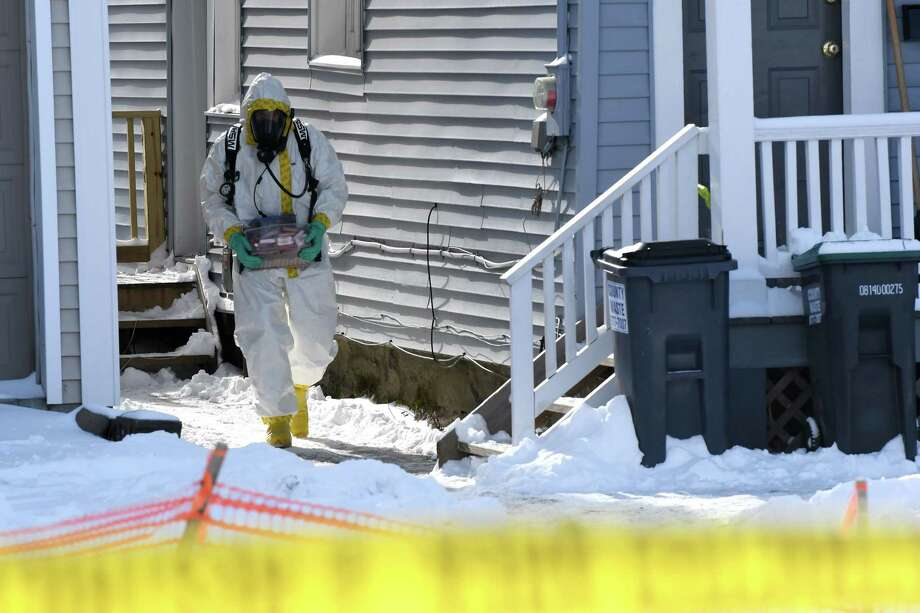 Evidence is collected from 16 Cherry St. on Friday, Feb. 10, 2017, in Saratoga Springs, N.Y. Fentanyl, a synthetic opioid painkiller that is 50 times as powerful as heroin, was found on surfaces inside the home that police raided before dawn on Friday, State Police said. (Will Waldron/Times Union) Photo: Will Waldron