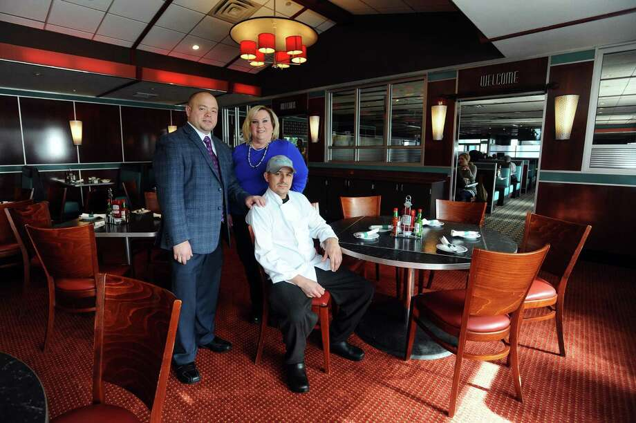 Stamford Diner owner Ari Thanos, general manager Laura O'Brien and executive chef Oscar Rivera (seated) pose inside the Stamford Diner on Harvard Ave. in Stamford, Conn. on Thursday, Feb. 2, 2017. Photo: Michael Cummo / Hearst Connecticut Media / Stamford Advocate