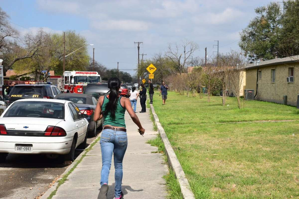 San Antonio police search for suspects in a shooting on the Northeast Side Friday, Feb. 10, 2017.