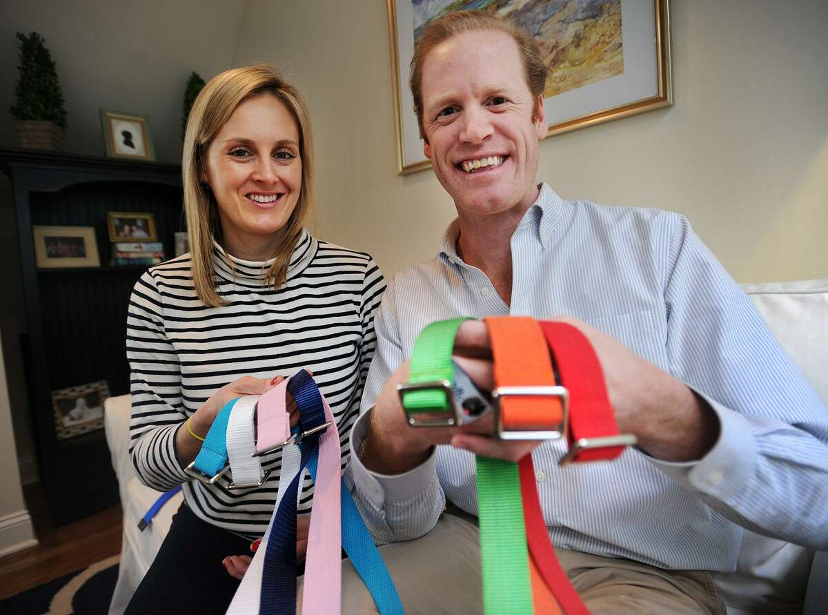 Ashley and Richard Perkin, of Fairfield, with some of their Gell belts at their home in the Southport section of Fairfield, Conn. on Wednesday, February 8, 2017. The couple started Gell Belts two years ago and now sell adult and kids lines from their website www.gells.org as well as through local boutiques.