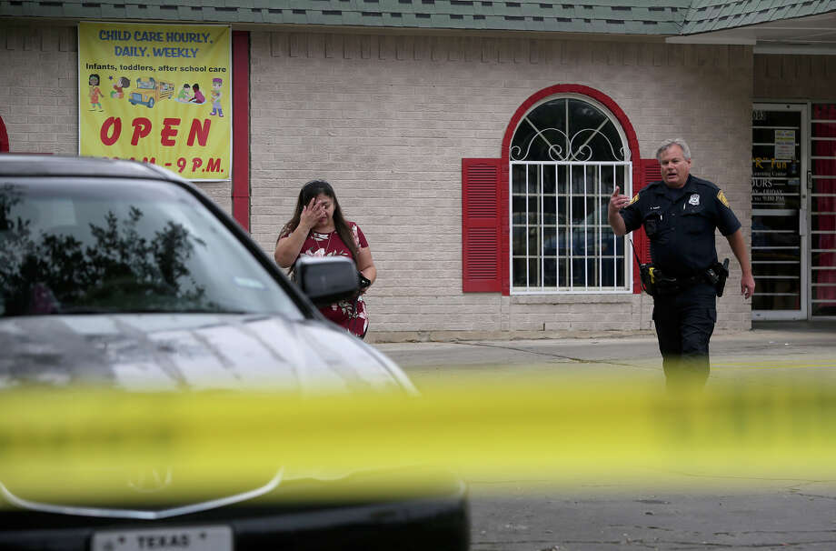"San Antonio police are investigating after shots were fired in the area of the 8000 block of Midcrown. Officers responded to the scene around 11:30 a.m. at the Kids ""R"" Fun day care center in the 8000 block of Midcrown Drive. The shots were fired from a car that drove into the day care parking lot, according to police. The suspect shot at a group of about 10 men who were gathered outside a gas station next to the day care. About four or five shots were fired, and a bullet went through the window of an apartment complex across the street from the day care, police said. Photo: John Davenport, San Antonio Express-News / ©San Antonio Express-News/John Davenport"