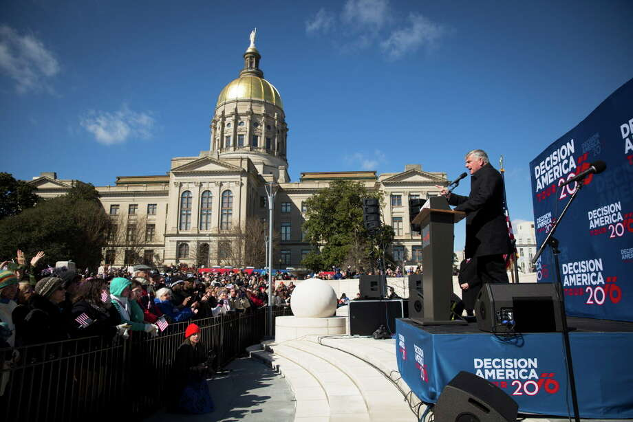"The Rev. Franklin Graham, evangelist and son of Billy Graham, speaks at Liberty Plaza outside the Capitol in Atlanta, during his ""Decision America Tour,"" Feb. 10, 2016. An executive order President Donald Trump signed on Jan. 27, 2017 gives preference to refugees who belong to a religious minority that has been persecuted, but a broad array of clergy, including evangelical and mainline Protestant leaders, has strongly denounced the order as discriminatory, misguided and inhumane.Keep going to see more photos from the protest over the ruling in Houston.  Photo: KEVIN D. LILES, NYT / NYTNS"