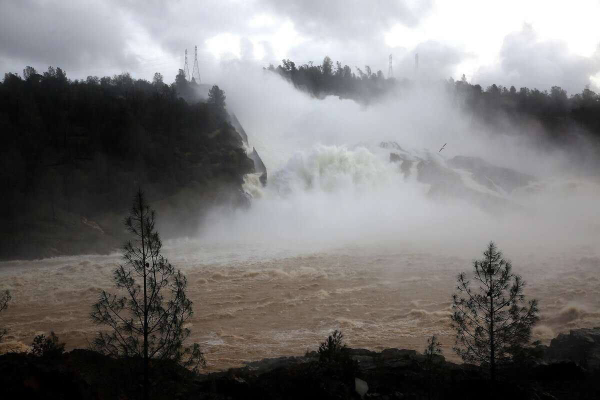 Water is released over the Lake Oroville spillway on Friday Feb. 10, 2017., in Oroville, Ca.