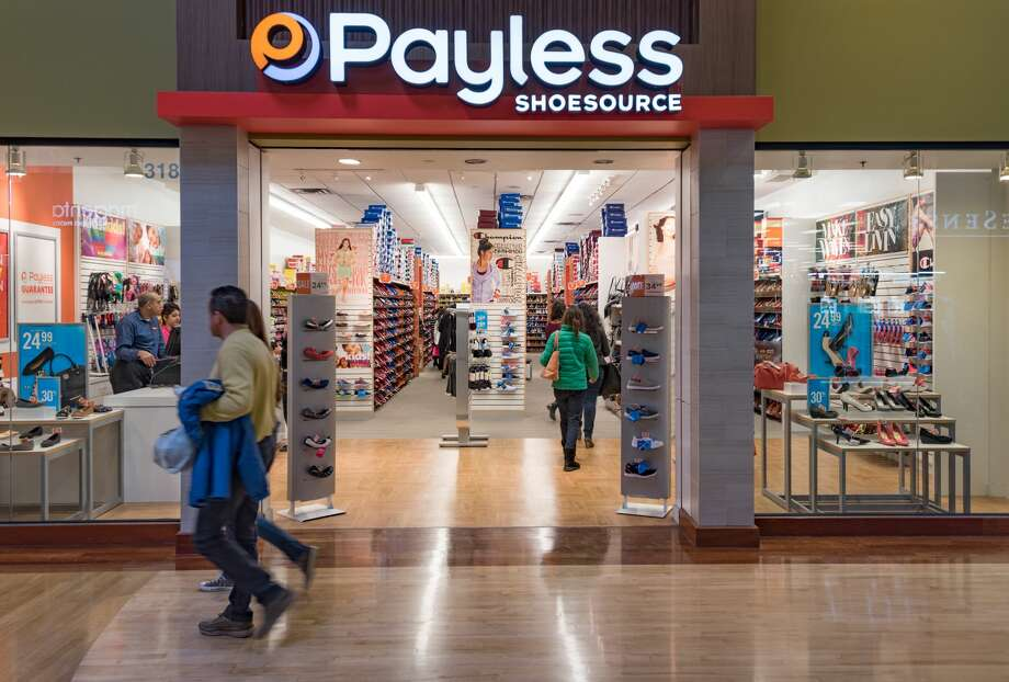 FILE-- Payless Shoe Store, Couple walking in a mall corridor. Photo: