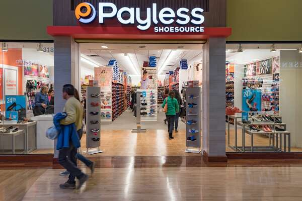 TORONTO, ONTARIO, CANADA - 2016/02/28: Payless Shoe Store, Couple walking in a mall corridor. (Photo by Roberto Machado Noa/LightRocket via Getty Images)
