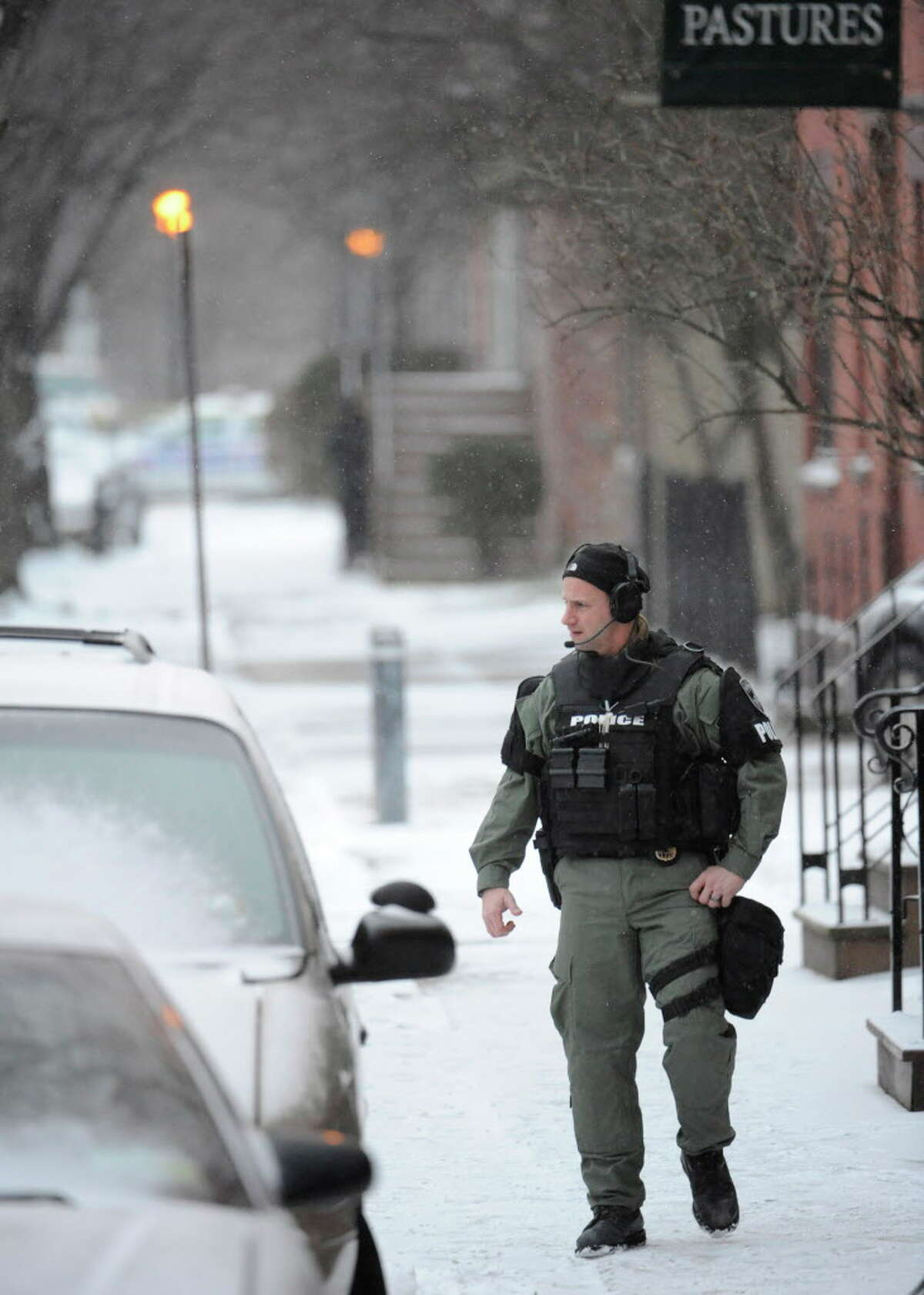 Albany Police SWAT team member Ken koontz works the radio at the scene of a hostage situation on Westerlo St in Albany December 23, 2010. (Skip Dickstein / Times Union)