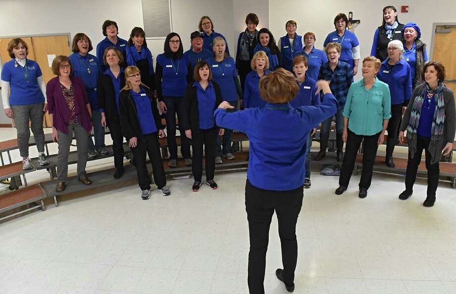 Jenn Hunter, assistant director, conducts the Saratoga Soundtrack Chorus as they rehearse at Knights of Columbus for their singing telegrams for Valentine's Day on Monday, Feb. 6 2017 in Saratoga Springs, N.Y.  (Lori Van Buren / Times Union) Photo: Lori Van Buren / 20039595A