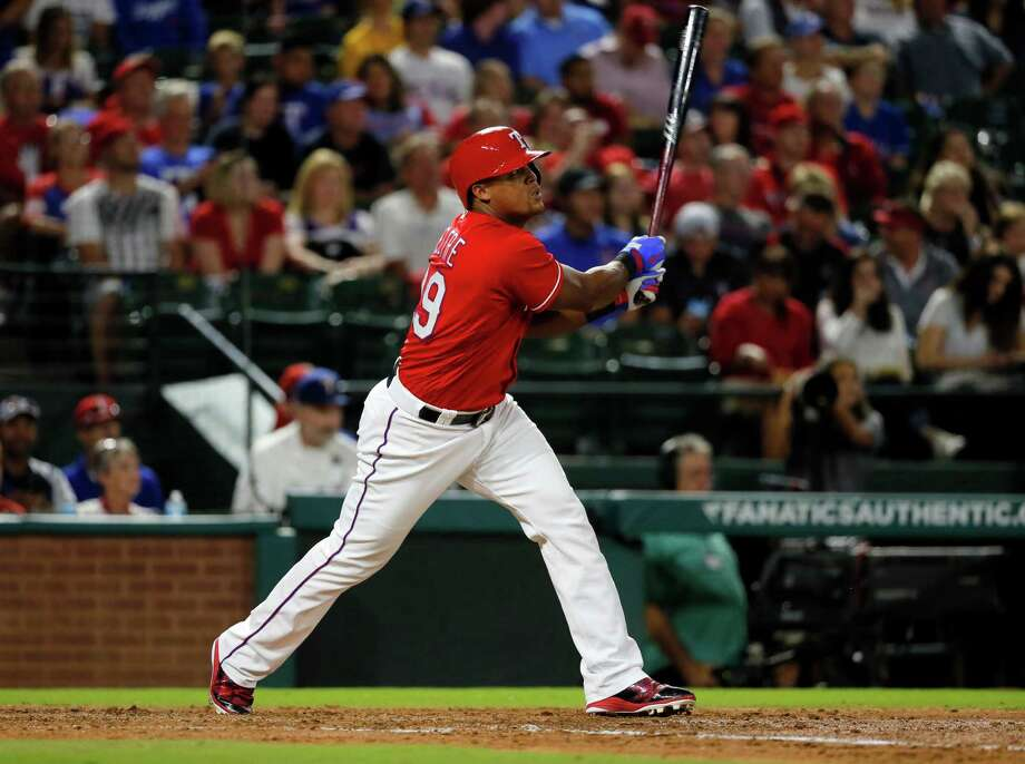 In this Sept. 30, 2016, file photo, Texas Rangers' Adrian Beltre follows through on a double to center off a pitch from Tampa Bay Rays' Matt Andriese in the third inning of a baseball game in Arlington, Texas. Beltre goes into his 20th major league season only 58 hits shy of 3,000 in his career, and after winning his fifth Gold Glove last year. Photo: Tony Gutierrez, Associated Press / Copyright 2017 The Associated Press. All rights reserved.