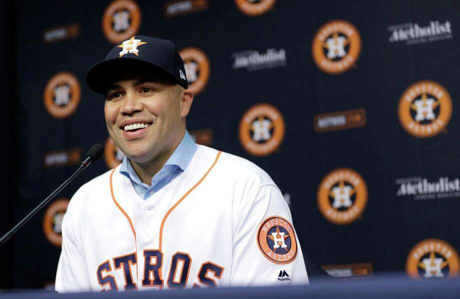 In this Dec. 5, 2016, file photo, outfielder Carlos Beltran smiles during a news conference to announce his signing a one-year contract with the Houston Astros in Houston. The Astros added Carlos Beltran, Josh Reddick and Brian McCann this offseason and general manager Jeff Luhnow thinks the trio of proven veterans will help Houston's young and talented core better deal with the ups and downs of a 162-game season. Photo: David J. Phillip, Associated Press / Copyright 2016 The Associated Press. All rights reserved.