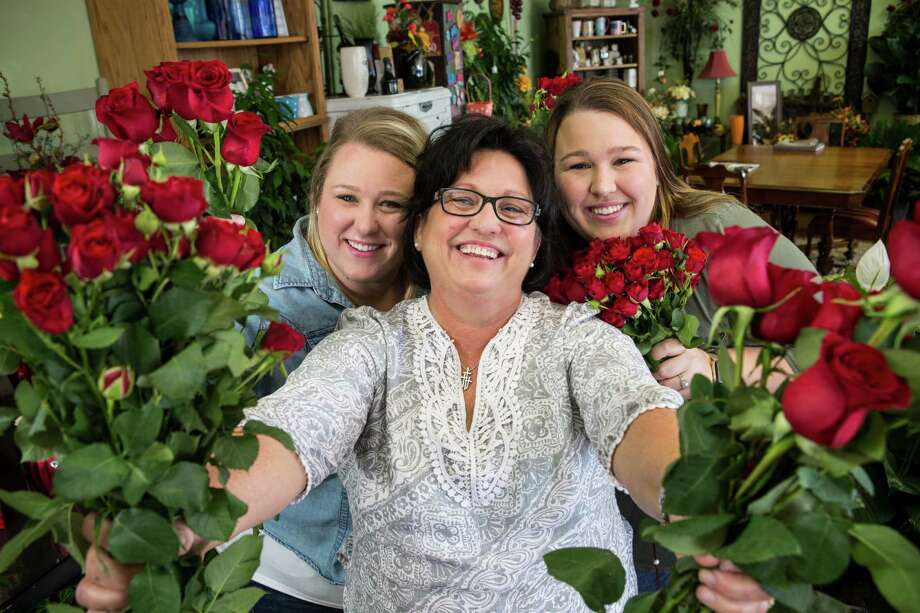 Ramona Ohl is flanked by her daughters, Olivia Ohl-Lara, left, and Odessa Ohl at their shop, Flowers by Adela.  Photo: Brett Coomer, Staff / © 2017 Houston Chronicle