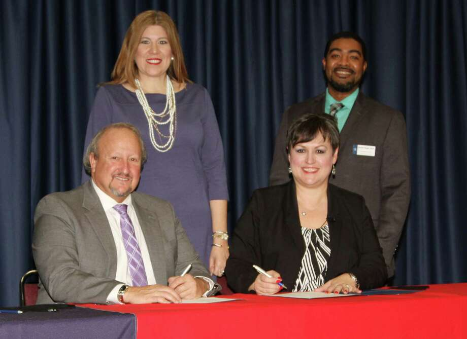 ECHS CEREMONIAL AGREEMENT. Tomball ISD Superintendent Huey Kinchen and Lone Star College–Tomball President Lee Ann Nutt signed a ceremonial agreement recognizing the establishment of Tomball Star Academy – an Early College High School. This joint initiative will enable students to earn a high school diploma, up to 60 college credit hours, and an associate of arts degree free of charge. Tomball Star Academy will also provide a rigorous, supportive learning environment that blends high school and the first two years of college. The new school is scheduled to open for the 2017-18 school year. Martha Salazar-Zamora, chief academic officer, Tomball ISD, and  Quentin Wright, vice president of instruction, Lone Star College–Tomball, joined the signing ceremony. Photo: Tomball ISD