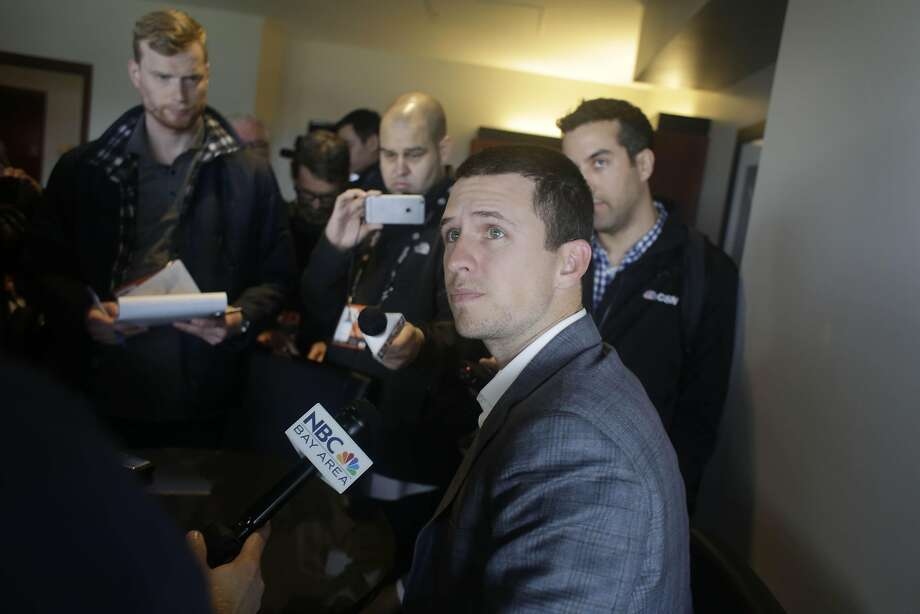 Buster Posey listens to a question at Friday's FanFest media day. Photo: Lea Suzuki, The Chronicle