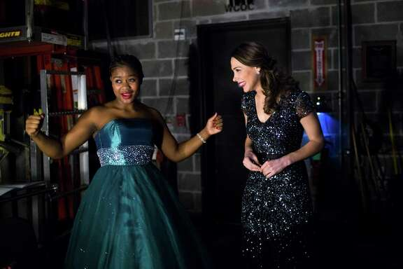 The Eleanor McCollum Competition for Young Singers finalists Siphokazi Moltena, left, and Anne Marie Stanley, right, do a victory dance after they performed at the Concert of Arias, the final round of the youth competition, Friday, Jan. 27, 2017, in Houston. ( Marie D. De Jesus / Houston Chronicle )