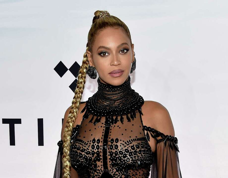 FILE - In this Oct. 15, 2016 file photo, singer Beyonce Knowles attends the Tidal X: 1015 benefit concert in New York.  Beyonce is nominated for Grammy Awards for best album, best song and record of the year. (Photo by Evan Agostini/Invision/AP, File) Photo: Evan Agostini, INVL / 2016 Invision