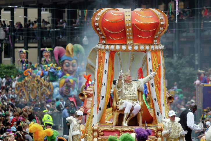 FILE - In this March 8, 2011, file photo, Rex, the King of Carnival rides in the Krewe of Rex as he arrives at Canal St. on Mardi Gras day in New Orleans. New Orleans is entering the height of its annual pre-Lenten Carnival season, culminating on Mardi Gras, or Fat Tuesday, which falls on Feb. 28 this year. Travelers to the city face an abundance of choices on how, when and where to take it all in. (AP Photo/Gerald Herbert, File)