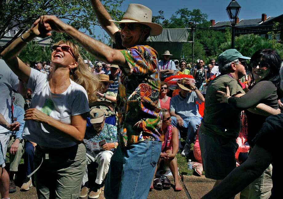 Richard and Alana Eager enjoy the music and sun as the French Quarter Festival opens in the New Orleans Jackson Square. Photo: Ted Jackson, Staff Photographer / The Times-Picayune