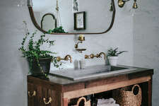 DO NOT USE. SUNSET MAGAZINE CONTENT.    Use earthy textures    The master bath is grounded by the natural materials: a custom vanity made of  salvaged wood , crates and baskets for storage, and a sink made of a special concrete-jute material that doesn't absorb stains. Touches of aged brass add an antique touch.   >  Trough 3619 NativeStone Bathroom Sink, from $1,225;  nativetrails.net . Connor wall mount faucet, from $749; Fords Mill Sconce, from $260; Linfield hook, from $25;  rejuvenation.com . Penarth walnut oval wall mirror, $299;  crateandbarrel.com .