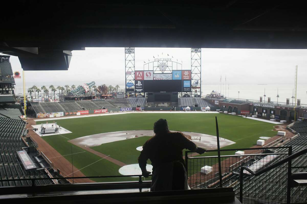 A worker looks over the field at AT&T Park while working on Friday, February 10, 2017 in San Francisco, Calif.