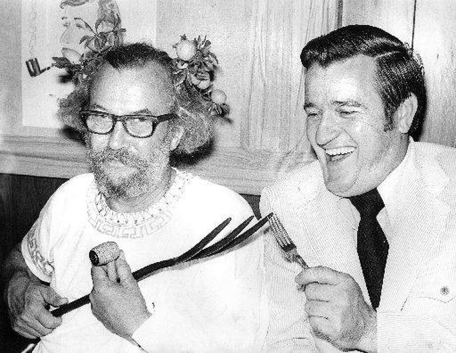 First Selectman Louis C. White, right, comparing forks with longtime theater advocate Edd Ashe, left, in the 1970s. Photo: Hearst Connecticut Media File Photo