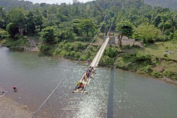 """Engineers led by Avery Bang work on the new Chameau footbridge in Haiti, opening a world of opportunity to villagers. It is featured in the IMAX film, """"Dream Big: Engineering Our World,"""" at the Maritime Aquarium at Norwalk."""