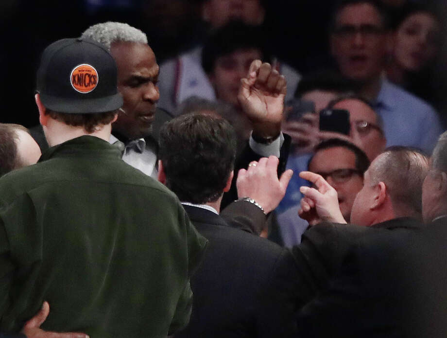 Former New York Knicks player Charles Oakley exchanges words with a security guard during the first half of an NBA basketball game between the New York Knicks and the LA Clippers Wednesday, Feb. 8, 2017, in New York. (AP Photo/Frank Franklin II) Photo: Frank Franklin II, Associated Press / Copyright 2017 The Associated Press. All rights reserved.