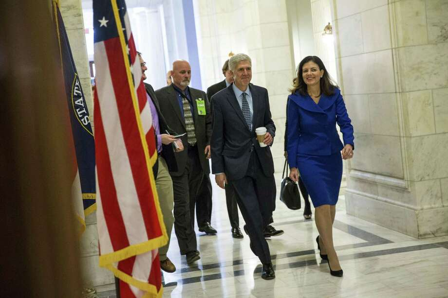 Judge Neil Gorsuch, the Supreme Court nominee and former Sen. Kelly Ayotte (R-N.H.) head to a meeting with Sen. Lindsey Graham on Capitol Hill on Feb. 2. Democrats should realize the gift they've just been given. Gorsuch will defy executive overreach. Photo: AL DRAGO /NYT / NYTNS