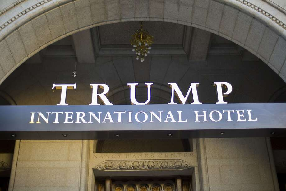 FILE - This Monday, Sept. 12, 2016, file photo, shows the exterior of the Trump International Hotel in downtown Washington. Several experts in government contract law say that President-elect Donald Trump will have to give up his stake in his prized Washington, D.C. hotel if he wants to be president. (AP Photo/Pablo Martinez Monsivais, File) Photo: Pablo Martinez Monsivais, Associated Press