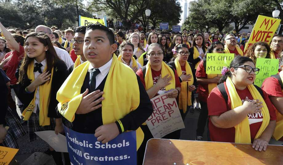 Parents, students and administrators recite the pledge of allegiance during a rally in support of school choice, on Jan. 24 in Austin, Texas. Senate Bill 3 appears to diminish accountability standards for choice schools. Photo: Eric Gay /Associated Press / Copyright 2017 The Associated Press. All rights reserved.