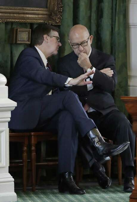 """Texas Lt. Gov. Dan Patrick, left, and Sen. John Whitmire, D-Houston, right, talk before the final vote on an anti-""""sanctuary cities"""" bill, Wednesday, Feb. 8, 2017, at the Texas Capitol in Austin, Texas. A late tweak to the bill zooming through the state Senate calls for jail time for sheriffs and other law enforcement officials who refuse to enforce federal immigration law and potentially allows for their removal from office. (AP Photo/Eric Gay) Photo: Eric Gay, STF / Associated Press / Copyright 2017 The Associated Press. All rights reserved."""