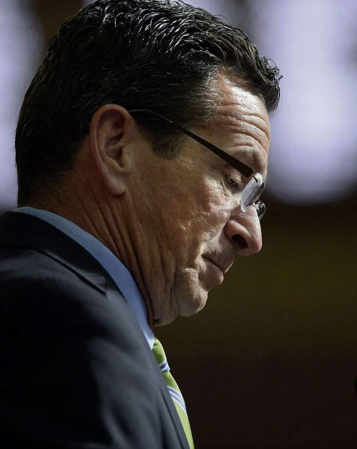 Connecticut Gov. Dannel P. Malloy looks down as he delivers his budget address at the state Capitol in Hartford Wednesday. Photo: Jessica Hill / Associated Press / FR125654 AP