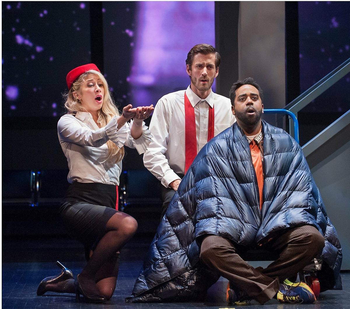 "Maya Yahav Gour (l.), Hadleigh Adams and Tai Oney in Jonathan Dove's ""Flight"" at Opera Parallèle"