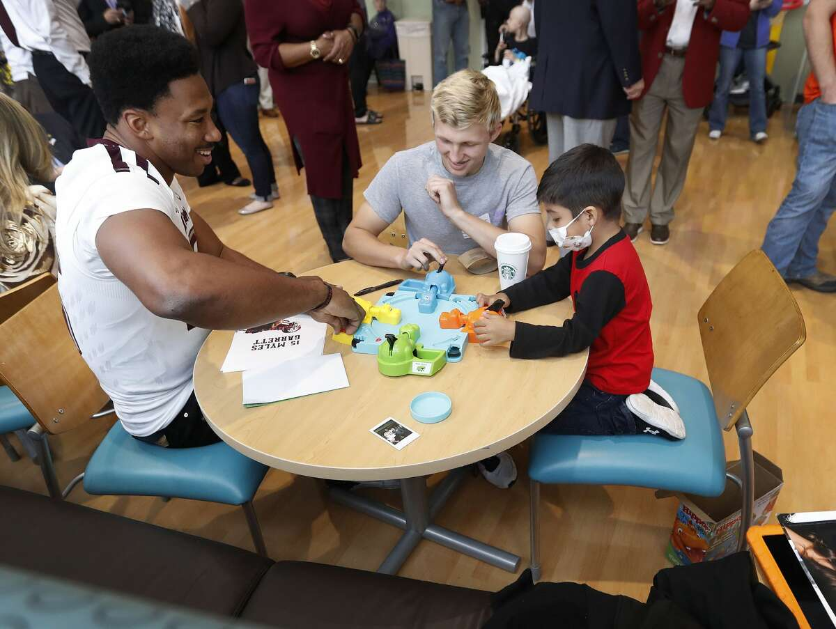 Myles Garrett plays Hungry Hippo with children at MD Anderson, Friday, February 10, 2017. Garrett, a DE from Texas A&M is projected as the overall No.1 draft pick in the upcoming NFL draft. ( Karen Warren / Houston Chronicle )