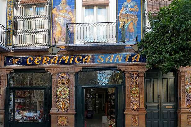 In Sevilla's Triana district, vintage storefronts proudly display the neighborhood's ceramic heritage.