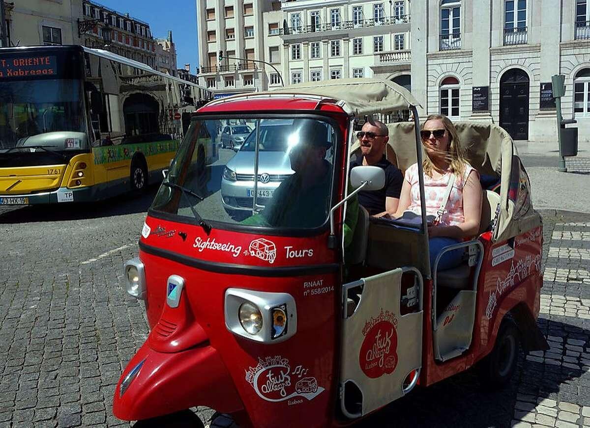 Little tuk-tuks are a fun way to sightsee around Lisbon.