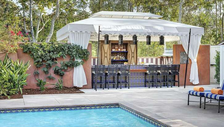 Next to Rancho Valencia�s adults-only pool, the new Rein bar serves cocktails, panini, poke and other light fare to guests in new spa cabanas as well as at the bar.