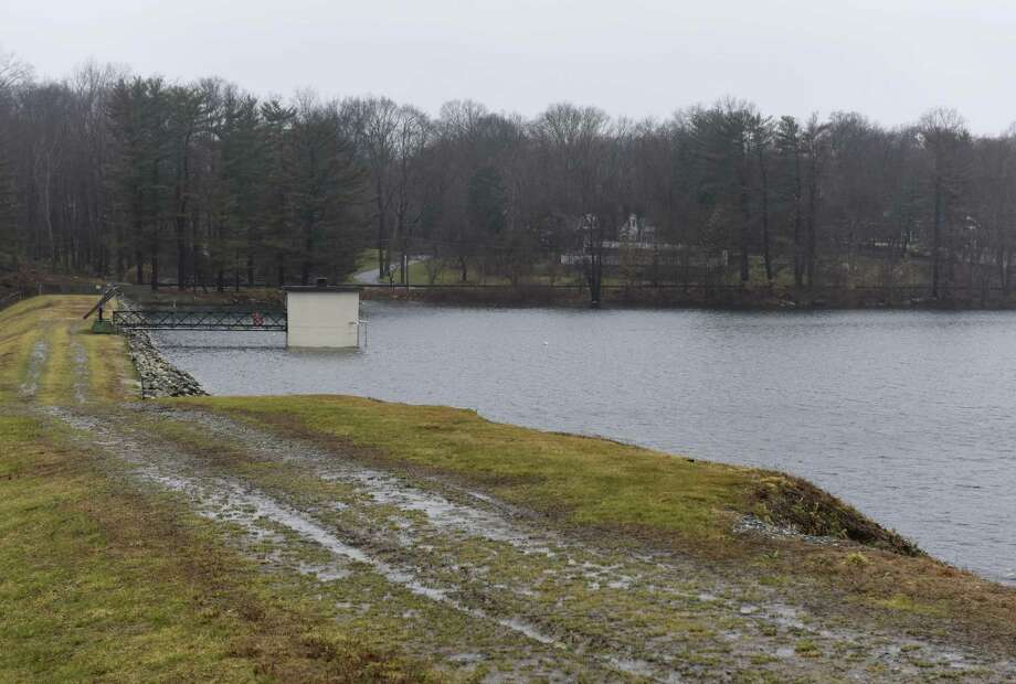 Putnam Reservoir on Jan. 24. Recent showers helped reservoir levels go up, but they're still far behind where they should be. The town is considering putting regulations in place to help conserve water year-round. Photo: Tyler Sizemore / Hearst Connecticut Media / Greenwich Time