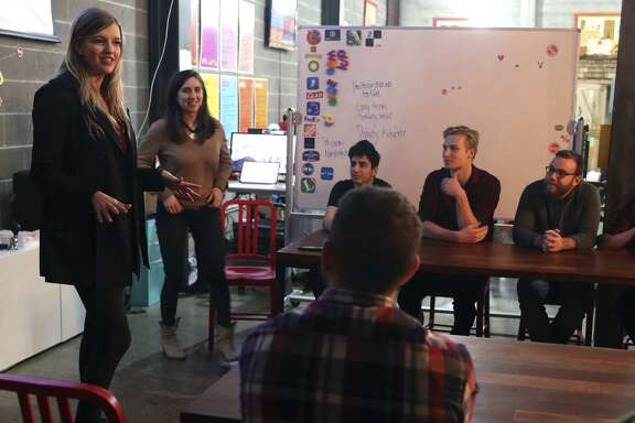"Professional dating coach Megan Merrill (left) leads a ""social hacks"" workshop in San Francisco, explaining how to build better relationships."