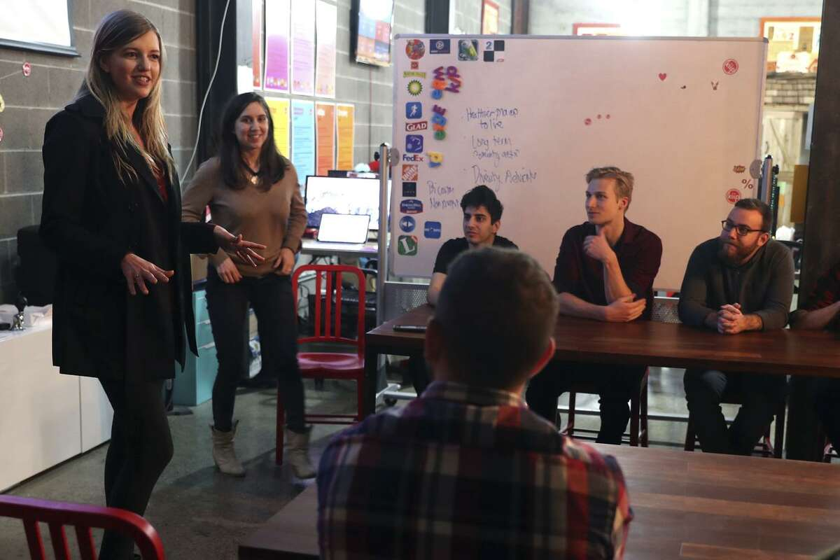 """Professional dating coach Megan Merrill (left) leads a """"social hacks"""" workshop in San Francisco, explaining how to build better relationships."""
