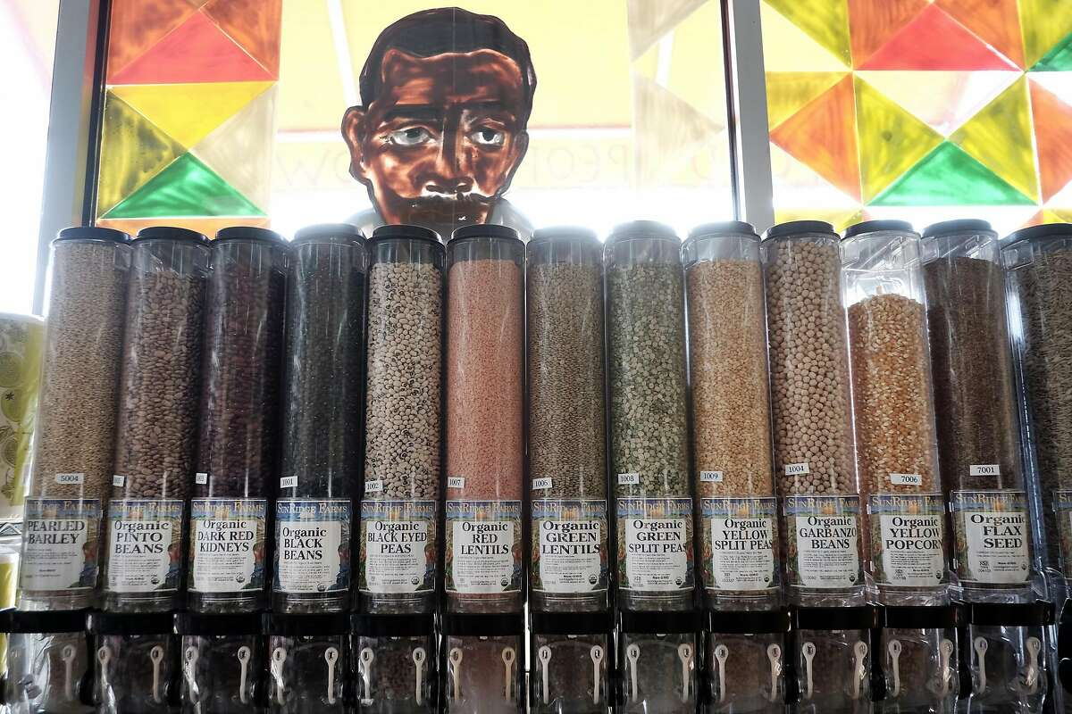 A picture is seen in a window above bulk bins at Mandela Foods Co-op in Oakland, CA on Friday, February 10, 2017.