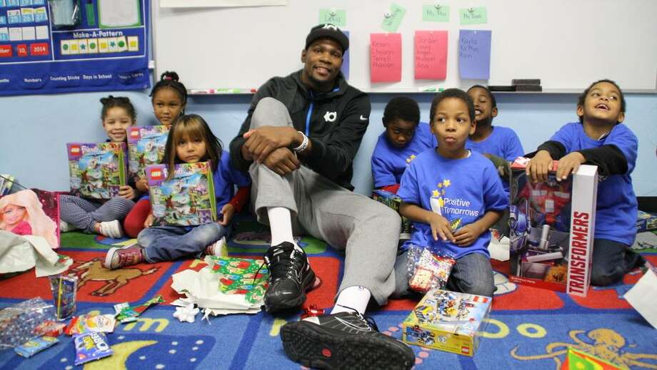 Professional basketball player Kevin Durant visits in 2014 with children at Positive Tomorrows, a school for homeless children in Oklahoma City that he supports.