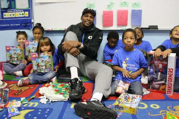 Kevin Durant visits in 2014 with children at Positive Tomorrows, the Oklahoma City school for homeless children that he supports.