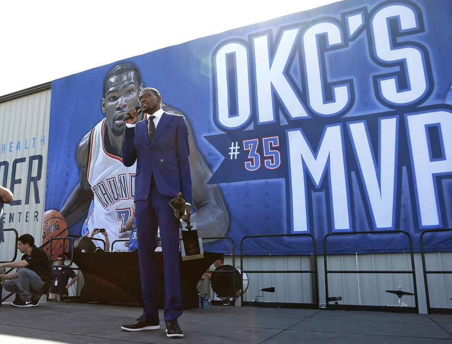 Oklahoma City Thunder's Kevin Durant speaks during a rally of fans following a news conference where he was announced as the winner of the 2013-14 Kia NBA Basketball Most Value Player Award in Oklahoma City, Tuesday, May 6, 2014. (AP Photo/Sue Ogrocki) Photo: Sue Ogrocki / Associated Press / AP