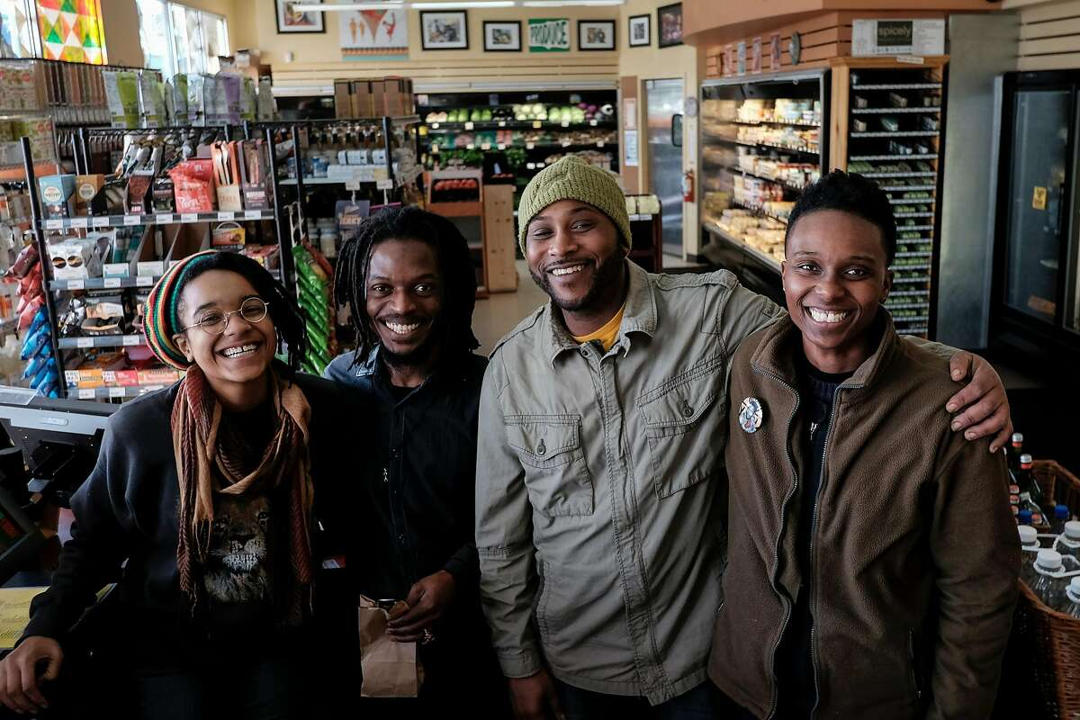 From left, Erin Clark, Fekida Wuul, James Bell, and Adrionna Fike pose for a portrait at Mandela Foods Co-op in West Oakland.