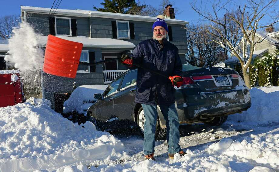 Above, Phil Sidebottom shovels his driveway on South Benson Road in Fairfield on Friday February 10, 2017, following the snowstorm Thursday that dumped up to a foot of snow in Fairfield, Conn. Photo: Erik Trautmann / Hearst Connecticut Media / Norwalk Hour