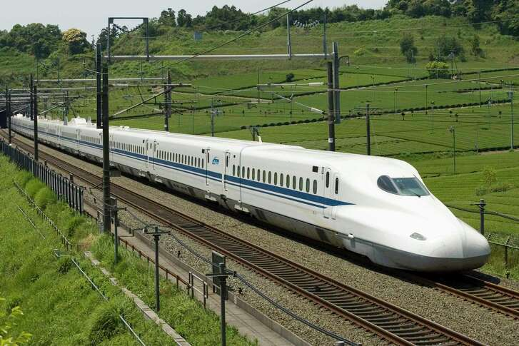 The planned high-speed rail line between Houston and Dallas would use overhead electrical lines and its own separated tracks to shuttle riders between the two metro areas, through mostly flat, rural land. The N700 train is shown in this photo illustration from Texas Central Railway, using images provided by Japan Railway Central. (Under permissin of JR Central)