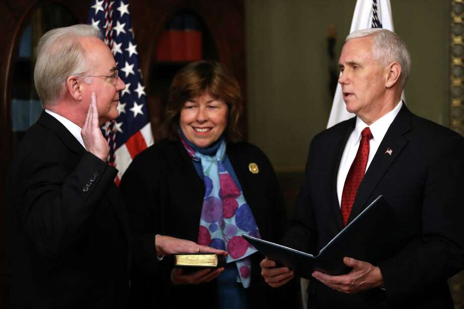 Vice President Mike Pence administers the oath of office to Health and Human Services Secretary Tom Price, accompanied by his wife Betty, Friday, Feb. 10, 2017,  in the in the Eisenhower Executive Office Building on the White House complex in Washington. (AP Photo/Andrew Harnik) Photo: Andrew Harnik, STF / Copyright 2017 The Associated Press. All rights reserved.